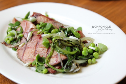 Grilled Ox Tongue w. Wild Garlic, Wood Sorrel, Braised Peas and Spring Onions ($14)