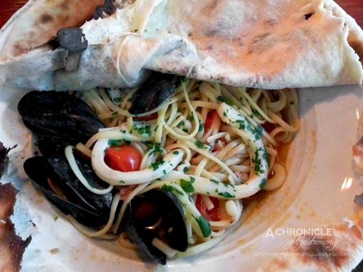 Linguine all Cartoccio - Homemade Linguine w. Calamari, King Prawns, Fish of the Day, Mussels, EVOO, White Wine, Tomato, Chili, Garlic and Parsley