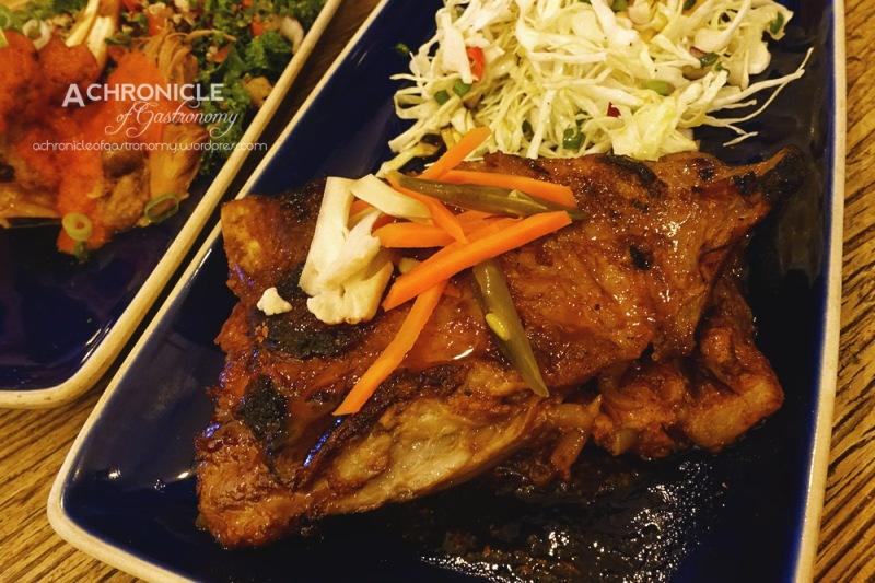 Marrano Caramelizado - Roasted Pork Shoulder in Agave, Orange and Chipotle Glaze, Cabbage Slaw $22