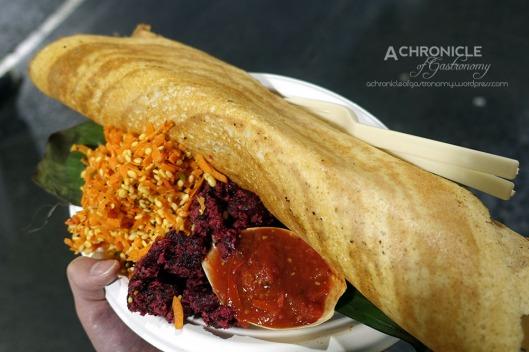 Babaji's Kitchen (27) Slow Cooked Beef Kallu Shappu Dosa, Beetroot Thoran, Kosambri, Tomato Chutney ($12)
