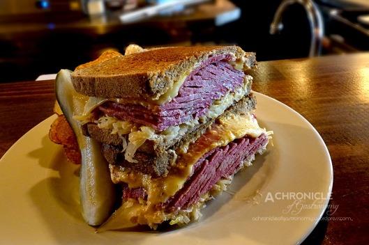 Toasted Reuben Sandwich - Dark Rye, 5 Points Deli Corned Brisket, Sauerkraut, Swiss, Russian Dressing ($16)
