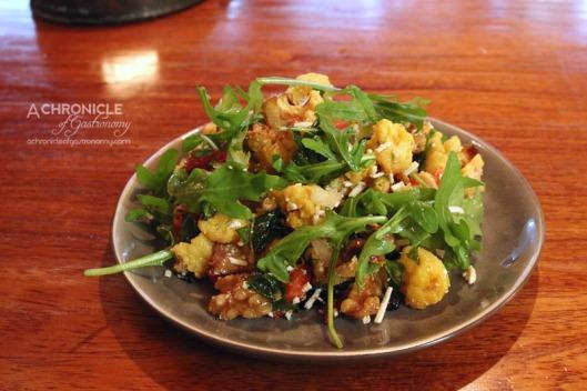Koy - Roasted Cauliflower w. Greens, Sundried Tomato, Feta, Currants, Roasted Nuts & Pomegranate Molasses ($12)