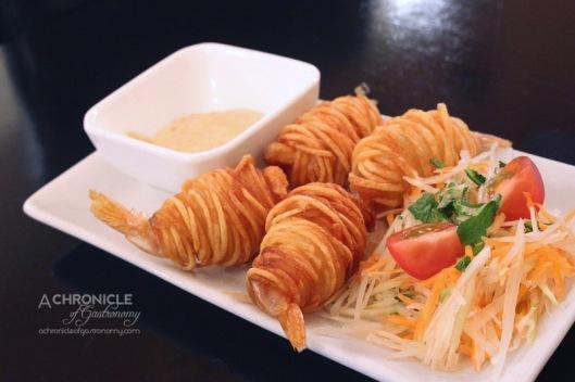 Masak Ku - Potato Prawn - Snap-fried Prawn Wrapped Around with Long Strands of Potato, Green Papaya Salad, Chilli Mayo ($9.50)